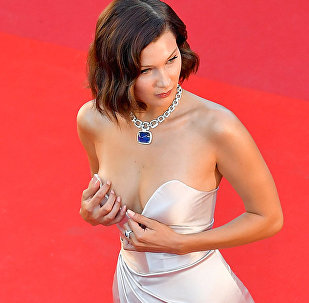 US model Bella Hadid poses as she arrives on May 17, 2017 for the screening of the film 'Ismael's Ghosts' (Les Fantomes d'Ismael) during the opening ceremony of the 70th edition of the Cannes Film Festival in Cannes, southern France