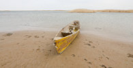 A boat is seen on the shore of the Aral Sea outside the village of Karateren, south-western Kazakhstan