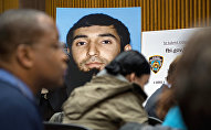 A photo of Sayfullo Saipov is displayed at a news conference at One Police Plaza Wednesday, Nov. 1, 2017, in New York. Saipov is accused of driving a truck on a bike path that killed several and injured others Tuesday near One World Trade Center.