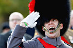 A soldier salutes as he parades past Britain's Prince Edward during the Remembrance Sunday Cenotaph service in London