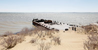 An abandoned ship lies between the coastline of the Aral Sea and sand dunes near the village of Akespe, south-western Kazakhstan, April 16, 2017. Akespe, home to some 250 people, and Karateren, inhabited by about 150, used to be dominated by fishermen until the water receded too far away - but it is now back in Karateren.
