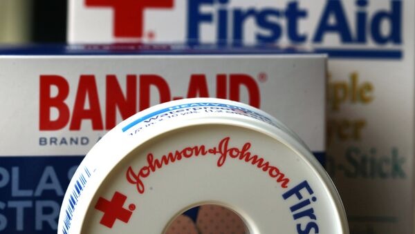 In this July 16, 2012, file photo, Johnson & Johnson products are displayed in Orlando, Fla. On Friday, Nov. 25, 2016, Johnson & Johnson said it is in early talks to buy Swiss drugmaker Actelion Pharmaceuticals Ltd. Both companies said there is no certainty that a deal will happen. - Sputnik Узбекистан